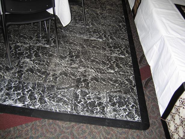 The black & white marbled pattern of the dance floor helps it look clean all night long.
