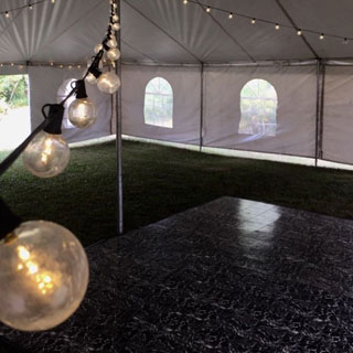 Warm white globe lights over a marble dance floor